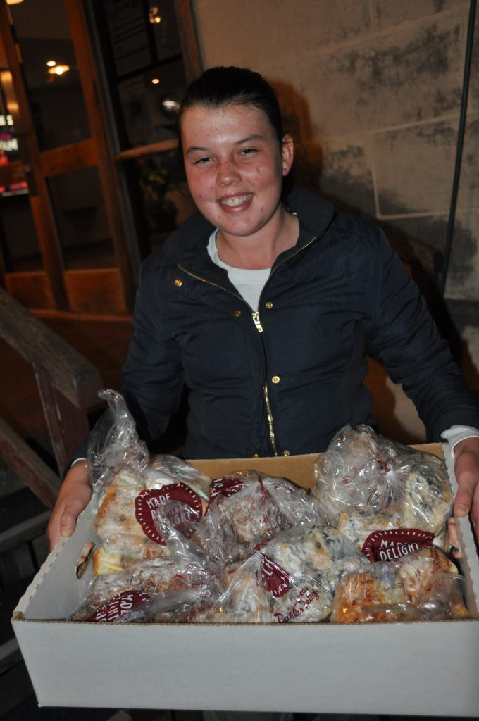 Volunteer Mia collected leftover scones to deliver to clients in our homelessness and community programs.