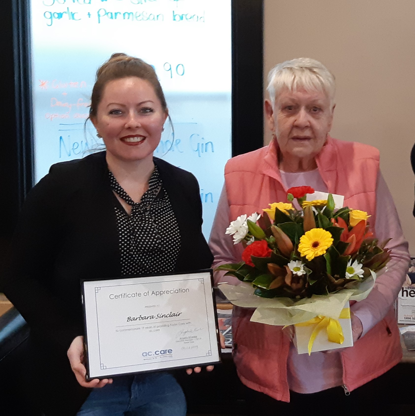GRATITUDE: ac.care Limestone Coast foster care program manager Dani Atkinson thanks Barb Sinclair for nearly 10 decades of welcoming children into her Mount Gambier home.