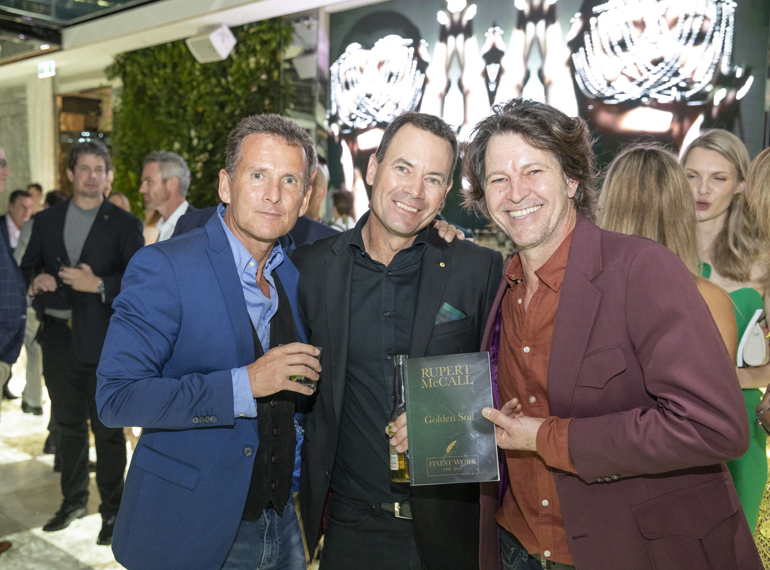 MILESTONE: Go Transit chief operating officer Rick Chapman, poet Rupert McCall OAM and Australian singer and musician Bernard Fanning at the launch of Mr McCall's Golden Soil poetry anthology.