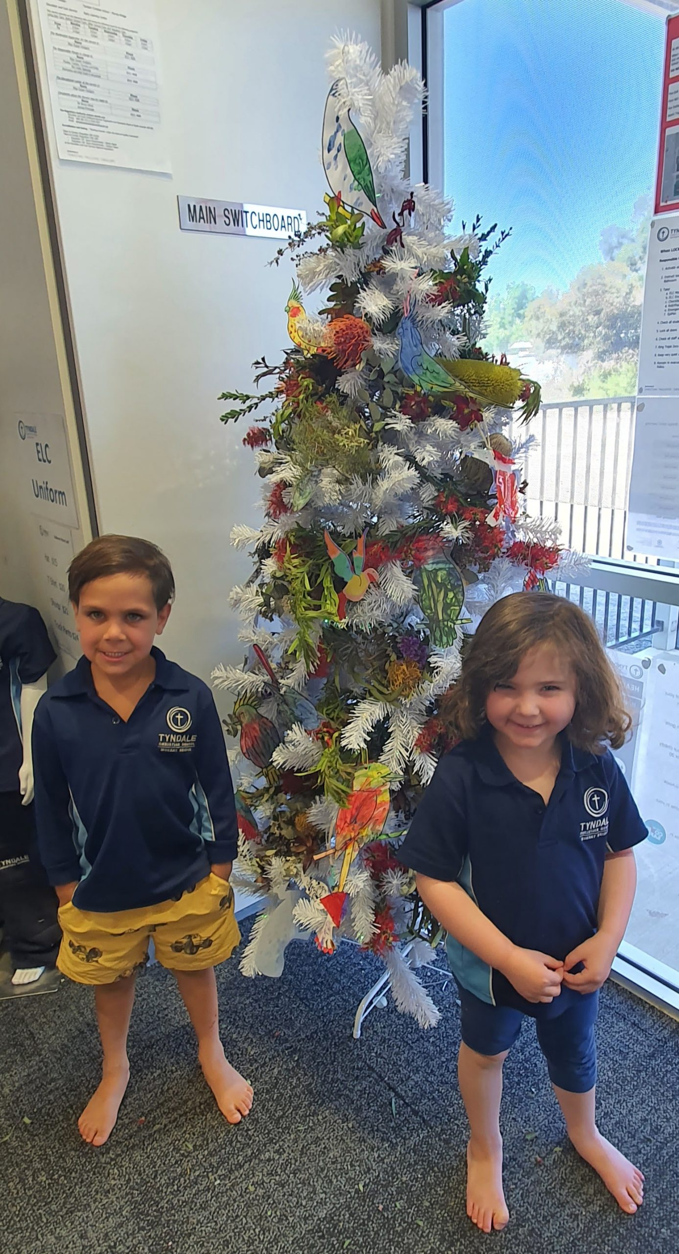 WORKING TOGETHER: Daniel and Alexis at the Tyndale Christian School enjoyed decorating a Christmas tree with other children as part of the ac.care Murraylands Communities for Children initiative.