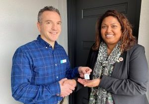 PROJECT MILESTONE: Habitat for Humanity South Australian executive director Ben Sarre hands over the keys to the Studio Purpose apartments to ac.care Murraylands homelessness program manager Thanuja Hiripitiyage.