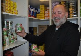 HELPING OUT: ac.care Mount Gambier volunteer Craig Shelton prepares food items for the agency's emergency relief program, which helps people in need across the Limestone Coast.